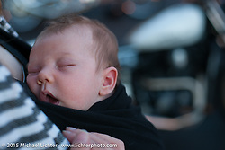 Baby Lock Olsen enjoying the pre-party for Born Free 6 bike show at Orange County Harley-Davidson. USA. June 26, 2014.  Photography ©2014 Michael Lichter.