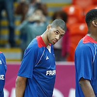 04 August 2012: Fabien Causeur, Nicolas Batum, and Kevin Seraphin are seen during the National Anthem prior to the 73-69 Team France victory over Team Tunisia, during the men's basketball preliminary, at the Basketball Arena, in London, Great Britain.