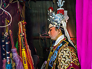 08 DECEMBER 2016 - BANGKOK, THAILAND:  A cast member backstage during a Chinese opera (also called ngiew in Thailand) performance at Pek Leng Keng Shrine in the Khlong Toei neighborhood of Bangkok. Public performances of music and celebration were banned during the first 30 days of the mourning period for Bhumibol Adulyadej, the Late King of Thailand. Now, nearly two months after the revered monarch's death, Bangkok street life is returning to normal and Chinese temples and shrines are once again scheduling operas.     PHOTO BY JACK KURTZ