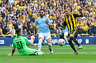 Ederson Moraes (31) of Manchester City makes a save from a shot at goal by Roberto Pereyra (37) of Watford during the The FA Cup Final match between Manchester City and Watford at Wembley Stadium, London, England on 18 May 2019.