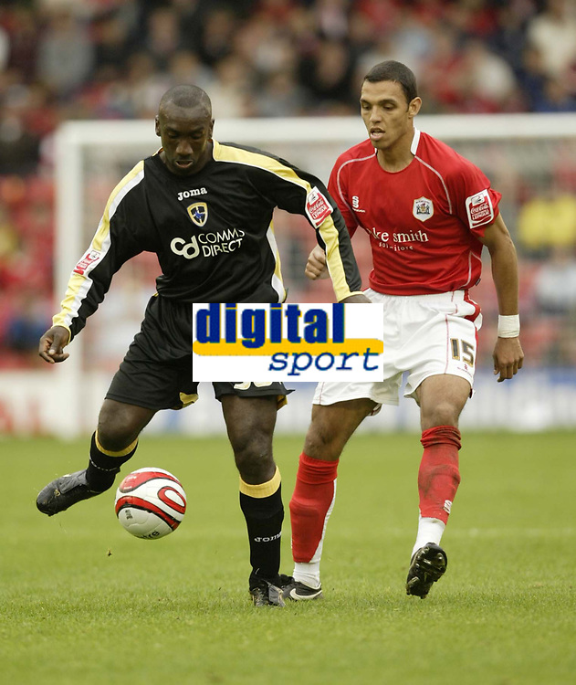 Photo: Aidan Ellis.<br /> Barnsley v Cardiff City. Coca Cola Championship. 29/09/2007.<br /> Cardiff's jimmy Floyd Hasselbaink is closely Watched By Barnsley's Anderson Da Silva