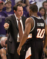 Oklahoma State assistant coach Sean Sutton (L) has a word with Byron Eaton (R) at Bramlage Coliseum in Manhattan, Kansas, February 4, 2006.  Oklahoma State  defeated K-State 63-61.