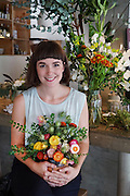 """Terri Chandler of Worm London, flower arrangements at a trendy restaurant """"Raw Duck"""" in London<br /><br />Terri Chandler of Worm London, based in Stoke Newington. Part of a recent 'start up'. She and her partner set up last year after taking diplomas in flower arrangement. They run a local business with local British Flowers which they buy from New Covent Garden Market. They work for restaurants, weddings and functions.<br /><br />British local flowers, grown nearby, count for around 10% of the UK market, traveling less than a tenth of their foreign counterparts which are often flown in from abroad. Nearly 90% of the flowers sold in the UK are actually imported, and many travel over 3000 miles. Local flower farms help biodiversity, providing food and habitat to a huge variety of wildlife, insects including butterflies, bugs, and bees. Often local flower farmers prefer to grow organic rather than using pesticides. British flowers bloom all the year around, even in the depths of winter, and there are local flower farms throughout the country.<br /><br />Many people like the idea of the just picked from the garden look, and come to flower farms throughout Britain to pick their own for weddings, parties and garden fetes. Others come for the joy of a day out in the countryside with their family. Often a bride and her family will come to pick the flowers for her own wedding, some even plant the seeds earlier in the year."""