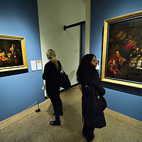 VENICE, ITALY - NOVEMBER 23:  Two women admire two different paintings by Lorenzo Lotto at the press preview of Tribute to Lorenzo Lotto - The Hermitage Paintings at Accademia Gallery on November 23, 2011 in Venice, Italy. The exhibition which includes two very rare & never seen before paintings opens from the 24th November 2011 to 26th February 2012 in Italy.