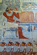 colorful bas-reliefs of Mehu presenting various offerings to the gods