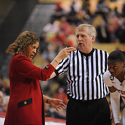 Rutgers Scarlet Knights head coach C. Vivian Stringer chats with guard Erica Wheeler (3) and a referee Bill Titus during second half Big East NCAA women's basketball action during Rutgers' 67-58 victory over West Virginia at the Louis Brown Rutgers Athletic Center.