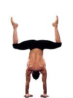 one caucasian man yoga handstand gymnastic acrobatics full length studio isolated on white background