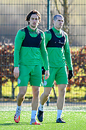 (LtoR) Joe Newell (#11) of Hibernian FC and Alex Gogic (#13) of Hibernian FC during the training session for Hibernian FC at the Hibs Training Centre, Ormiston, Scotland on 26 February 2021, ahead of the SPFL Premiership match against Motherwell.