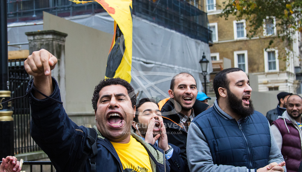"Downing Street, London, November 5th 2015. British Prime Minister David Cameron welcomes Egyptian President Abdel Fatah al-Sisi to 10 Downing Street as demonstrations in support and counter-protests against his visit to the UK by a coalition of human rights groups take place in Whitehall. PICTURED:  Anti Sisi potesters jeer pro-Sisi supporters, their hands making the four finger ""Rabia"" symbol, associated with the Tarhir Square stand-off that eventually saw Morsi elected and months later removed in a Sisi coup. // Licencing Contact: paul@pauldaveycreative.co.uk Mobile 07966 016 296"