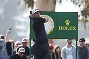 Adam Scott plays his shot from the ninth tee during the Genesis Invitational third round at Riviera Country Club, Saturday, Feb. 15, 2020, in the Pacific Palisades area of Los Angeles.