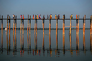 U Bein Bridge is a crossing that spans the Taungthaman Lake near Amarapura in Myanmar. The 1.2 km long bridge dates from 1850 and is believed to be the oldest and longest teakwood bridge in the world.