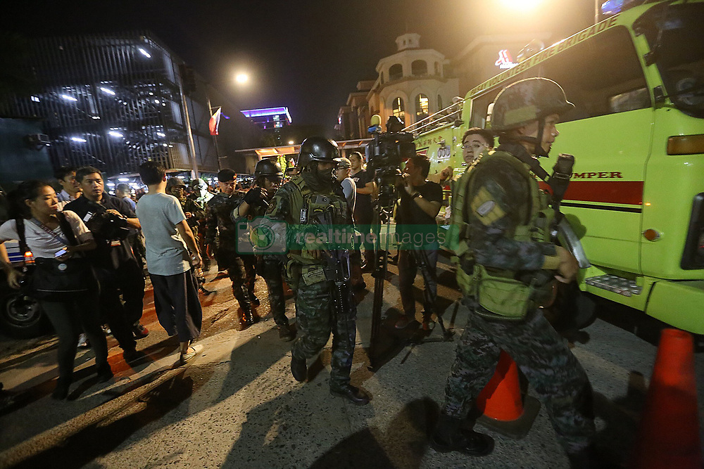 June 2, 2017 - Pasay City, Philippines - Security forces secure the surroundings of Resorts World Manila after an attack. A gunman with an assault rifle burst into the casino, fired shots and set gaming tables on fire on Friday. There is no indication the attack was an act of terrorism, the country's police chief said. (Credit Image: © Xinhua via ZUMA Wire)