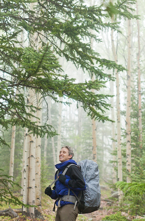 David Coffey on the Hankins Pass Trail in aspen and pine forest on a misty morning in the Lost Creek Wilderness, Colorado.