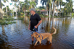 Andrew Perini walks his neighbor's dog, Arnie, along 10th Avenue and Polk Street in Hollywood, FL, USA, the day after Hurricane Irma came through South Florida. Perini said he's lucky his home did not flood. Photo by Susan Stocker/Sun Sentinel/TNS/ABACAPRESS.COM