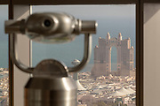 Coin-operated binoculars and Fairmont Marina Abu Dhabi seen from the observation deck at the Jumeirah Etihad Towers. It is the highest vantage point in Abu Dhabi and offers stunning views across the city and the Arabian Gulf, Abu Dhabi, United Arab Emirates