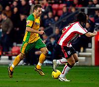 Photo: Alan Crowhurst.<br />Southampton v Norwich City. Coca Cola Championship. 16/12/2006. Darren Huckerby (L) attacks for Norwich.