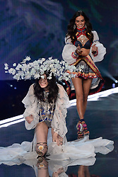 Ming Xi and Gizele Oliveira on the catwalk for the Victoria's Secret Fashion Show at the Mercedes-Benz Arena in Shanghai, China