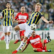 Fenerbahce's Dirk Kuyt (L) and Spartak Moscow's during their UEFA Champions League Play-Offs, 2nd leg soccer match Fenerbahce between Spartak Moscow at Sukru Saracaoglu stadium in Istanbul Turkey on Wednesday 29 August 2012. Photo by TURKPIX