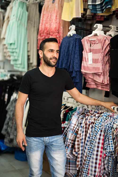 Izhac Makani, an Israeli who is a descendant of Iranian parents, is seen at his family owned clothes store, Dulce Mia, in the Levinsky Market in southern Tel Aviv, Israel, on April 16, 2015. The majority of the Levinsky Market vendors are traditional Iranian Jews, many of whom fled the Islamic Republic after Ayatollah Khomeini rose to power in 1979.