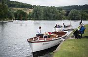 "Henley on Thames, United Kingdom. 2016 Henley Masters' Regatta. Henley Reach. England. on Saturday  09/07/2016   [Mandatory Credit/ Peter SPURRIER/Intersport Images]<br /> <br /> Umpire Launch. ""Bosporos"",  Rowing, Henley Reach, Henley Masters' Regatta.<br /> <br /> General View,  Henley Reach, venue, for the 2016 Henley Masters Regatta."