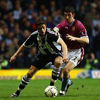 Fotball. Engelsk Premier League 02.04.2002.<br /> Aston Villa v Newcastle.<br /> Mark Delaney Aston Villa.<br /> Laurent Robert, Newcastle.<br /> Foto: Tim Parker, Digitalsport.