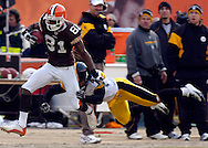 MORNING JOURNAL/DAVID RICHARD.Antonio Bryant of Cleveland gets by Troy Polamalu of Pittsburgh for a first down yesterday in the third quarter.