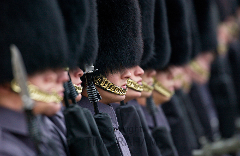 Guardsmen on Parade in winter grey coats, London, UK