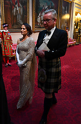 Stephanie Grisham and Secretary of State for Environment, Food and Rural Affairs, Michael Gove arrive through the East Gallery during the State Banquet at Buckingham Palace, London, on day one of the US President's three day state visit to the UK.