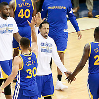 10 June 2016: Golden State Warriors guard Shaun Livingston (34) congratulates Golden State Warriors guard Stephen Curry (30) and Golden State Warriors forward Draymond Green (23) during the Golden State Warriors 108-97 victory over the Cleveland Cavaliers, during Game Four of the 2016 NBA Finals at the Quicken Loans Arena, Cleveland, Ohio, USA.