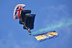 © Licensed to London News Pictures.  04/06/2017; Torbay, Devon, UK. The Tigers parachute display team with a Union Jack flag at the Torbay Airshow 2017. The 2017 Torbay Airshow returns this weekend on Saturday 3 and Sunday 4 June with an action packed programme of world class air displays. The world's premier aerobatic team The Red Arrows will be debuting a new routine in the first display of their season, featuring their trademark combination of close formations and precision flying. The full display programme for the weekend begins on the Saturday between 2-3pm with The Tigers Freefall Parachute Display Team, Team Raven Aerobatic Display Team, the Percival Piston Provost and the Strikemaster. From 3-4pm will be the highly anticipated display by the Red Arrows, former British Female Aerobatic Champion Lauren Richardson in her Pitts Special S1-S and world aerobatic competitor Gerald Cooper in his Xtreme XA41. Finishing off the action packed afternoon from 4-5pm will see displays from the AutoGyro, the Battle of Britain Memorial Flight aircraft, the PBY5A Catalina seaplane, The Blades and the Royal Air Force's Typhoon FGR4. Sunday afternoon will see each of the aircraft take to the skies again before the weekend closes with a final display from the RAF Chinook team. The two day show, which had its inaugural event last year, takes place on Paignton Green with the Bay providing a stunning natural amphitheatre for viewing the air displays and the perfect location for a large coastal airshow event. To stay up to date with the latest Torbay Airshow news and updates follow @torbayairshow on Facebook, Twitter and Instagram or visit www.torbayairshow.com. Picture credit : Simon Chapman/LNP