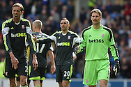 Peter Crouch and Asmir Begovic of Stoke react after a penalty is awarded against their side . Barclays Premier league match, Cardiff city  v Stoke city at the Cardiff city stadium in Cardiff, South Wales on Saturday 19th April 2014. pic by Mark Hawkins, Andrew Orchard sports photography,