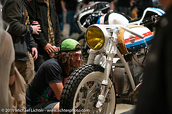 Checking out Jeremy Hutch's Hutchbilt custom 1979 BMW R80 with internal controls and completely handbuilt other than the motor and motor cradle. On display at the Handbuilt Show. Austin, TX. USA. Saturday April 21, 2018. Photography ©2018 Michael Lichter.