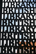 Metal gates of the British Library made from metal text. London, UK