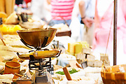 Spice seller at a market. An old fashioned scale to weigh the spices. Collioure. Roussillon. France. Europe.