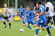 AFC Wimbledon midfielder Dean Parrett (18) dribbling in a congested midfield during the EFL Sky Bet League 1 match between AFC Wimbledon and Rochdale at the Cherry Red Records Stadium, Kingston, England on 30 September 2017. Photo by Matthew Redman.