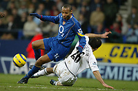 Fotball<br /> England 2004/22005<br /> Foto: SBI/Digitalsport<br /> NORWAY ONLY<br /> <br /> Arsenal v Bolton<br /> Barclays Premiership. 15/01/2005. <br /> <br /> Thierry Henry of Arsenal tumbles under the challenge of Tal Ben Haim of Bolton Wanderers.