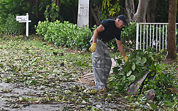 Al Naar, 70, of Ocean Ridge picks up branches outside his home after Hurricane Irma on Monday, September 11, 2017. Photo by Jim Rassol/Sun Sentinel/TNS/ABACAPRESS.COM