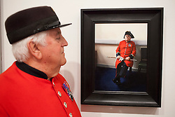 © Licensed to London News Pictures. 20/06/2012. LONDON, UK. Tom Mullaney, a Chelsea Pensioner, looks on at his portrait painted by artist Louise Pragnell entitled 'Tom, Waiting', hung as one of the featured works at this years BP Portrait Award.  The annual British Petroleum sponsored event runs from the 21st of June to the 23rd of September and highlights the work of portrait artists working in a variety of styles and techniques . Photo credit: Matt Cetti-Roberts/LNP