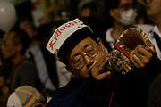 An anti Nuclear protestor blows a conch shell at the Friday night protests around the parliament building in Nagatacho, Tokyo, Japan Friday October 12th 2012