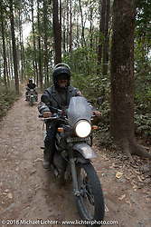 Kelly Modlin riding out through the forest from the Kusma Gyadi Bridge on Day-7 of our Himalayan Heroes adventure riding from Tatopani to Pokhara, Nepal. Monday, November 12, 2018. Photography ©2018 Michael Lichter.