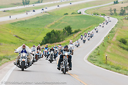 """Rich Robbins aka Buddha"""" and Jon and Pinky Barwood lead the annual Michael Lichter - Sugar Bear Ride hosted by Jay Allen from the Easyriders Saloon during the Sturgis Black Hills Motorcycle Rally. SD, USA. Sunday, August 3, 2014.  Photography ©2014 Michael Lichter."""