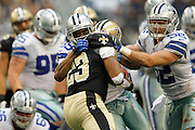 Dallas Cowboys cornerback Brandon Carr (39) and inside linebacker Dan Connor (52) tackle New Orleans Saints running back Pierre Thomas (23) at Cowboys Stadium in Arlington, Texas, on December 23, 2012.  (Stan Olszewski/The Dallas Morning News)
