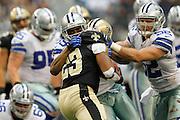 Dallas Cowboys cornerback Brandon Carr (39) and inside linebacker Dan Connor (52) tackle New Orleans Saints running back Pierre Thomas (23) at Cowboys Stadium in Arlington, Texas, on December 23, 2012.  (Stan Olszewski/The Dallas Morning News)