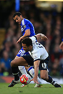 Mousa Dembele of Tottenham Hotspur  is tackled by Pedro of Chelsea. .Barclays Premier league match, Chelsea v Tottenham Hotspur at Stamford Bridge in London on Monday 2nd May 2016.<br /> pic by Andrew Orchard, Andrew Orchard sports photography.