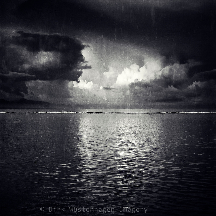 Thunderstorm over the Indic Ocean with the light of the rising sun reflecting on clouds. <br /> <br /> Prints & more: http://society6.com/DirkWuestenhagenImagery/eClipse-Ttg_Print