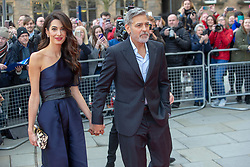 George and Amal Clooney, representing the Clooney Foundation for Justice, arrive at the People's Postcode Lottery charity gala at McEwan Hall, Bristo Square.