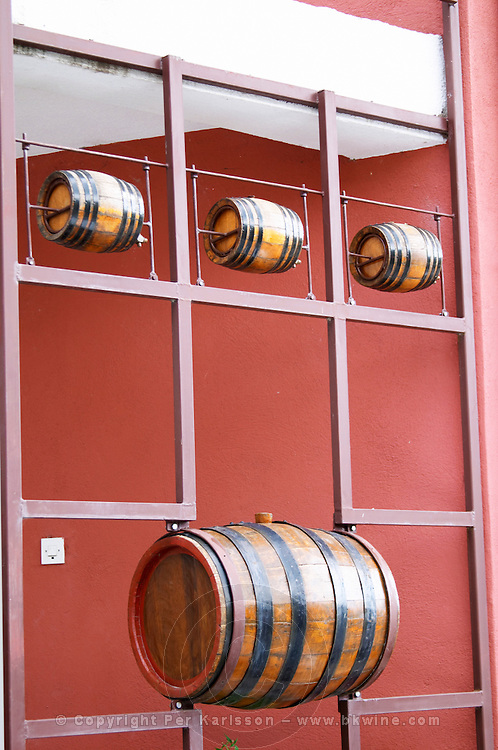 Decoration of small wine barrels outside the winery. Vukoje winery, Trebinje. Republika Srpska. Bosnia Herzegovina, Europe.