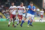 Rochdale Defender, Jim McNulty (4) battles for possession  during the EFL Sky Bet League 1 match between Rochdale and Bradford City at Spotland, Rochdale, England on 21 April 2018. Picture by Mark Pollitt.