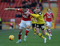 Bristol City Derrick Williams vies for possession with Fleetwood Town's David Ball<br /> <br /> Photographer Ashley Crowden/CameraSport<br /> <br /> Football - The Football League Sky Bet League One - Bristol City v Fleetwood Town - Sunday 1st February 2015 - Ashton Gate - Bristol<br /> <br /> © CameraSport - 43 Linden Ave. Countesthorpe. Leicester. England. LE8 5PG - Tel: +44 (0) 116 277 4147 - admin@camerasport.com - www.camerasport.com