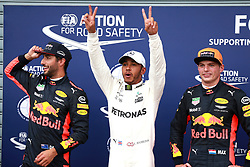 September 2, 2017 - Monza, Italy - LEWIS HAMILTON, center, of the Mercedes AMG Petronas F1 Team, celebrates pole position flanked by Red Bull Racing drivers DANIEL RICCIARDO, left, and MAX VERSTAPPEN, who qualified 2nd and 3rd respectively, for the FIA Formula One Grand Prix of Italy. (Credit Image: © Hoch Zwei via ZUMA Wire)